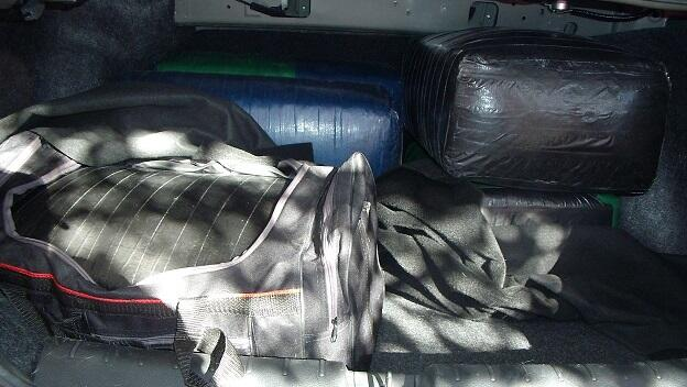 Officers removed bundles of marijuana from the trunk of a smuggling vehicle