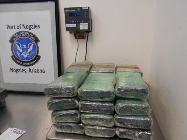 Officers seized multiple packages of cocaine that was hidden within the spare tire of a smuggling vehicle