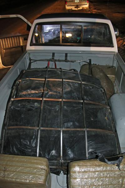 More than 200 pounds of marijuana was seized from a smuggler who had picked it up after it had been dropped from an ultra light aircraft.