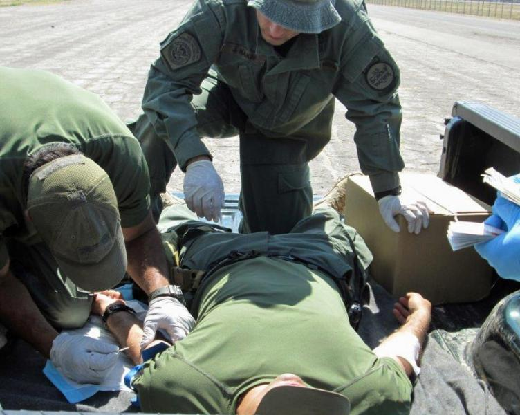 Agents practicing triage/first aid on a simulated patient