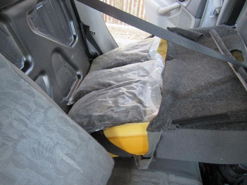 Officers removed more than 30 pounds of meth from behind the back seats of a smuggling vehicle