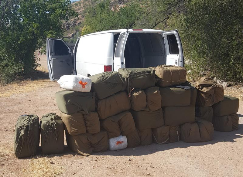 Agents discovered more than 1,000 pounds of marijuana inside of a cargo van after the driver and passenger attempted to flee on foot
