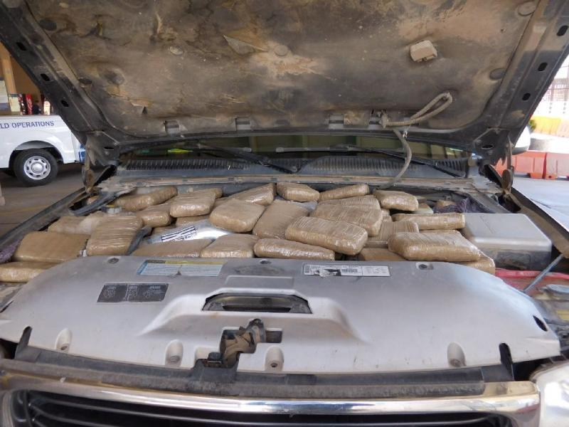 Officers at the RHC Port of Douglas discovered numerous packages of marijuana when they looked under the hood of a smuggling vehicle referred for secondary inspection