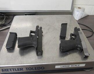 Officers seized two handguns before they could be taken into Mexico