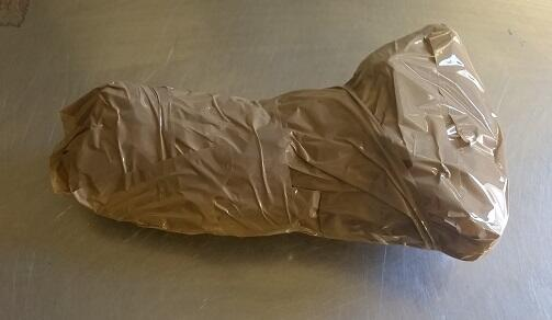 A smuggler agreed to remove a package from within her underclothing