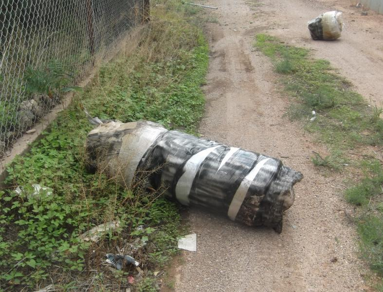 Agents seized the large bundle of marijuana which was found near the fence in Douglas, Ariz.