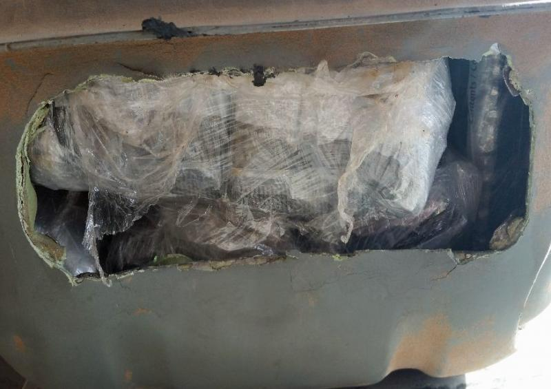 When officers removed the fuel tank of a smuggling vehicle, they discovered packages of cocaine and heroin inside.