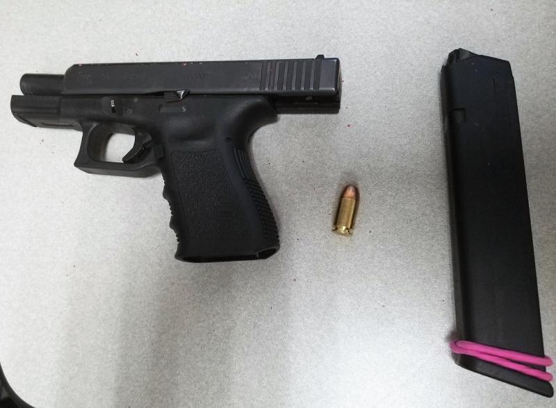 Agents seized a loaded handgun and a small amount of meth from the driver of a smuggling vehicle