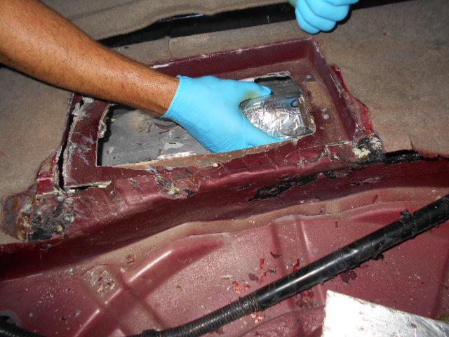 The rear cargo area of a smuggling vehicle was where officers located a combination of meth, heroin and cocaine