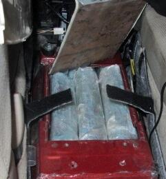 Officers at the Port of San Luis discovered 17.5 pounds of cocaine within the center console of a smuggling vehicle