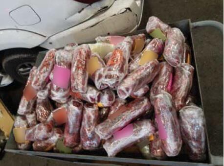 Officers removed more than 200 packages of meth from a smuggling vehicle
