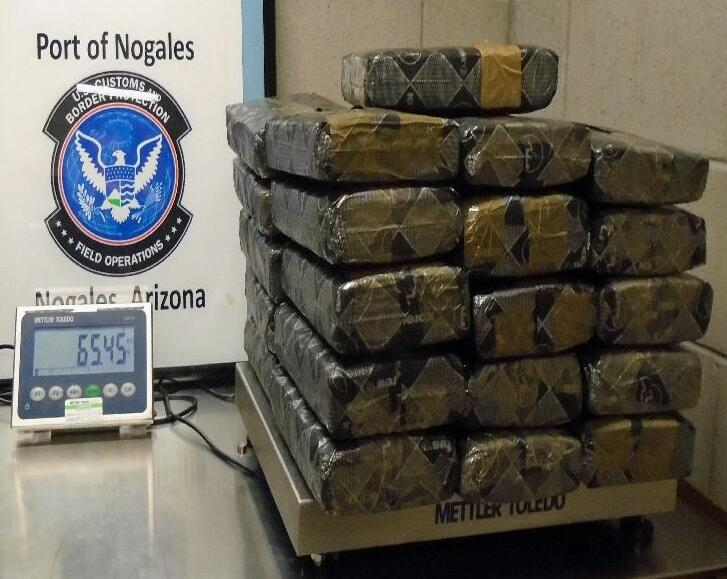 More than 65 pounds of marijuana were recovered from within the gas tank of a smuggling vehicle, by officers at the Nogales West Mariposa crossing.