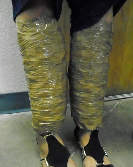 When officers raised the woman's pant legs, they discovered packages of meth that were wrapped around her shins
