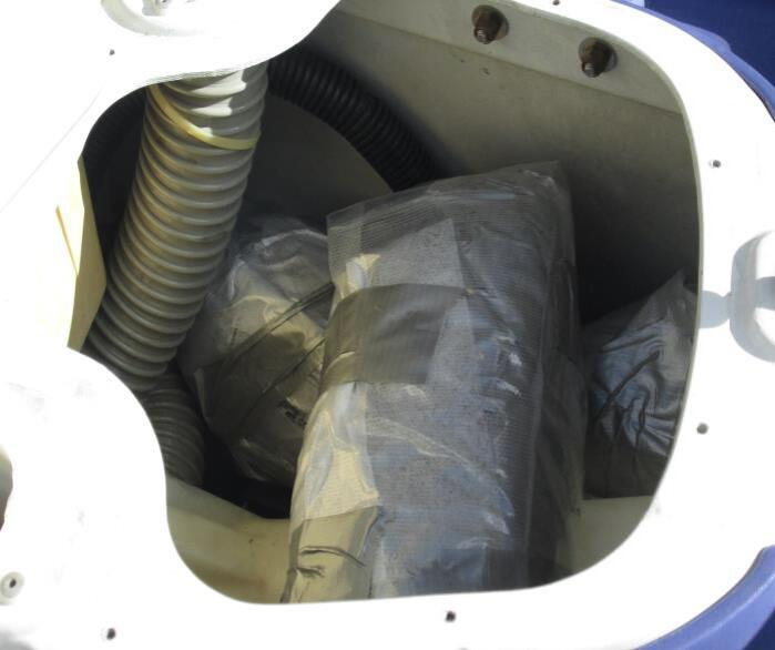 CBP officers discovered packages of marijuana underneath the seat of a watercraft.