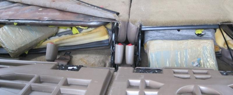 When officers took apart the seats of a smuggling vehicle, they located a total of eight packages of drugs