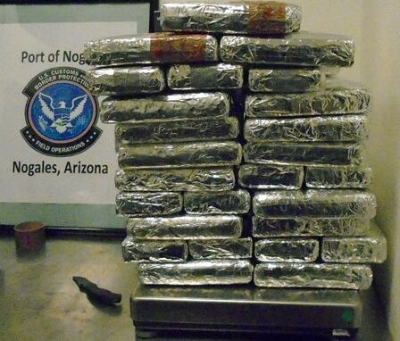 CBP officers removed 60 packages of cocaine from the rear cargo area of a smuggling vehicle
