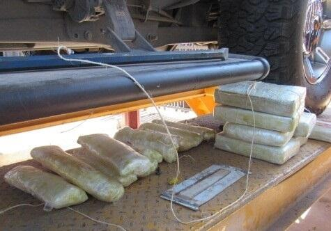Officers removed cocaine, meth and heroin from the rocker panels of a smuggling vehicle
