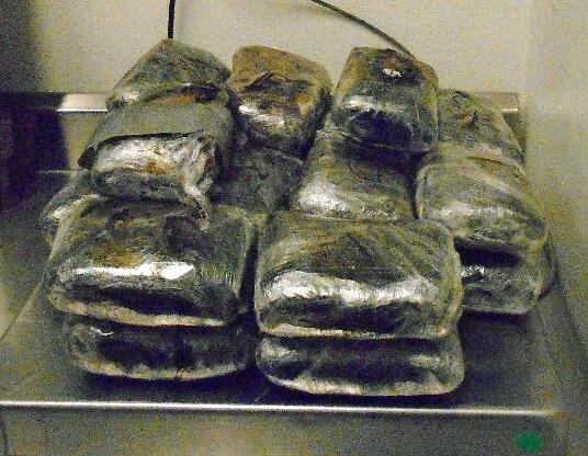 CBP officers seized a combination of 14 pounds of heroin and 27 pounds of meth that was hidden behind the rear bumper