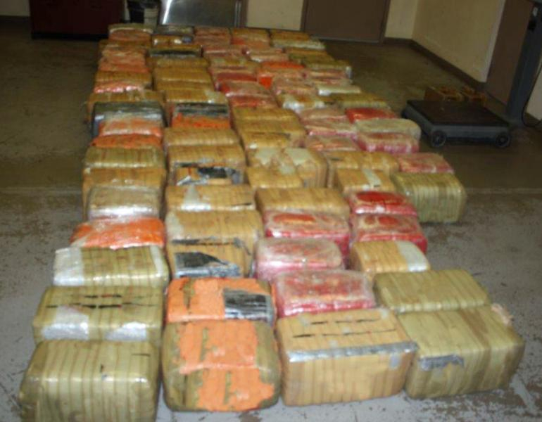 Photo of  nearly 1400 pounds of marijuana tossed over the border fence into the U.S.