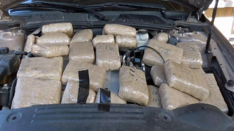 Officers at the Port of Douglas discovered packages of marijuana when they lifted the hood of a smuggling vehicle