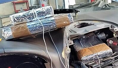 A CBP canine alerted officers to the dashboard of a smuggling vehicle, where fentanyl and heroin were removed