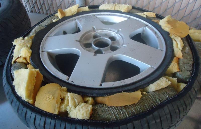 The tires of a smuggling vehicle are found to contain packages of marijuana, by CBP officers in Douglas, Ariz.