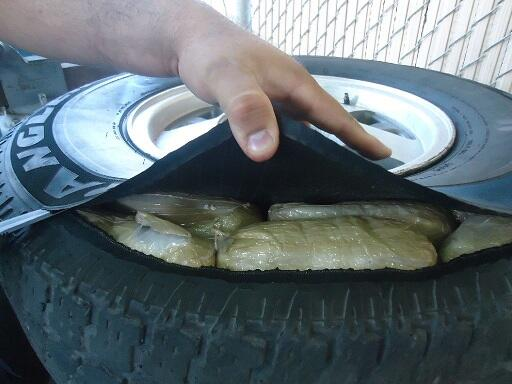 Drug smugglers attempted to hide marijuana packages inside of the tires of a smuggling vehicle