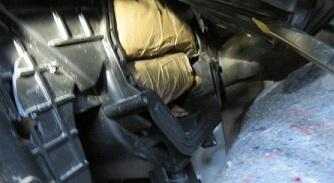 A CBP canine led officers to the dash of a smuggling vehicle, where a combination of cocaine and meth were hidden