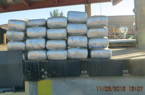 More than 700 pounds of marijuana were seized from within a trailer, which was carrying a vehicle