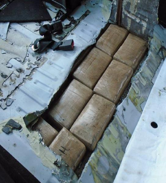 Fourteen packages of cocaine were removed from within the rear cargo area of a smuggling vehicle