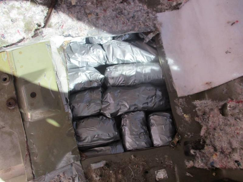 Officers discovered more than 170 packages of meth within the floorboard of a smuggling vehicle
