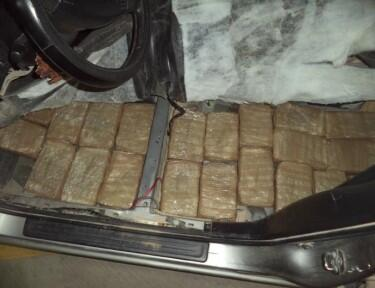 Officers removed packages of marijuana that was hidden beneath the seats of a smuggling vehicle