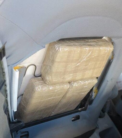 Ofrficers removed packages of marijuana from throughout a smuggling vehicle