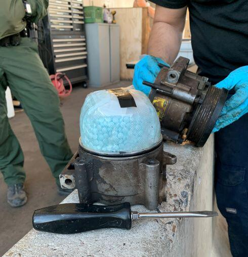 A CBP canine alerted agents to the discovery of fentanyl inside of a smuggling vehicle's a/c compressor.