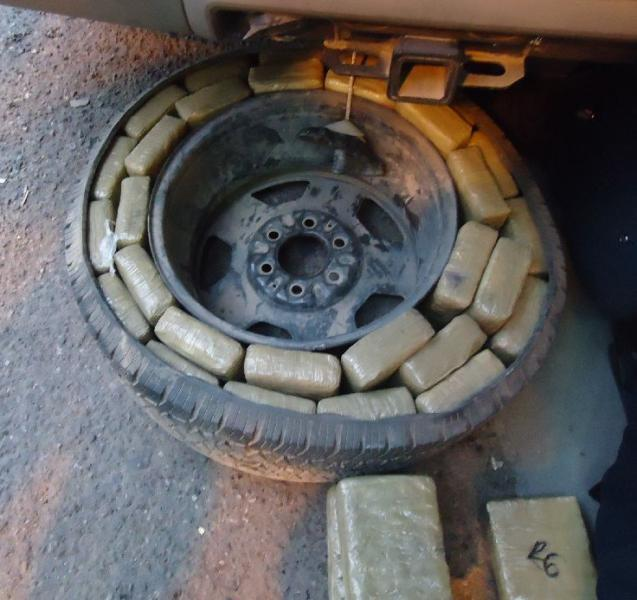 CBP officers removed more than 400 packages of marijuana from a smuggling vehicle, including these hidden within the spare tire