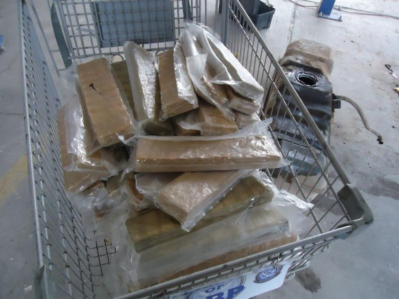 Fifty packages of marijuana were removed from the gas tank of a smuggling vehicle