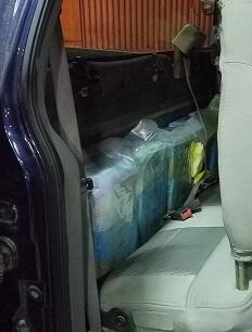 packages of marijuana were removed from behind the seats of a smuggling vehicle