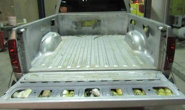 Officers removed a combination of meth, heroin and fentanyl from beneath a bedliner removed from a Dodge truck