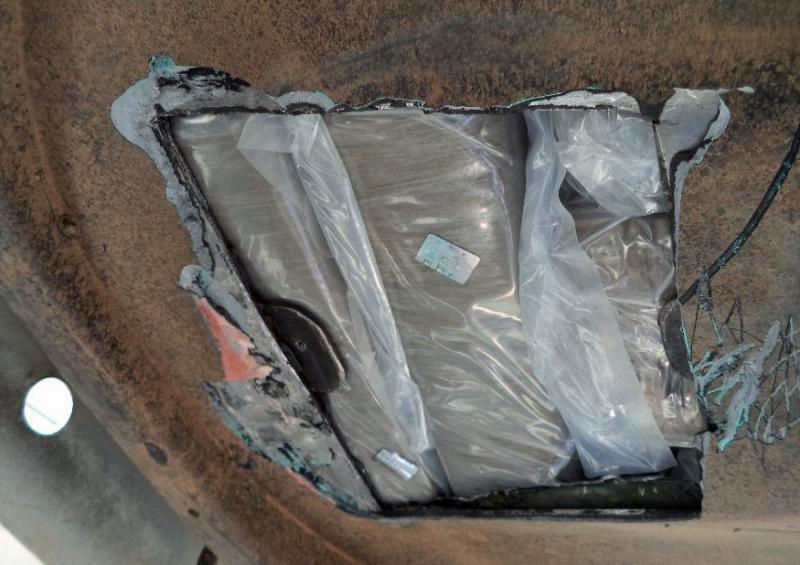 Officers at the DeConcini crossing discovered and seized more than 15 pounds of heroin from a hidden compartment hidden by the spare tire