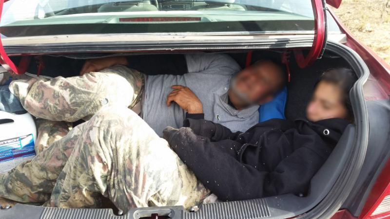 Mexican nationals inside the trunk of a smuggling vehicle