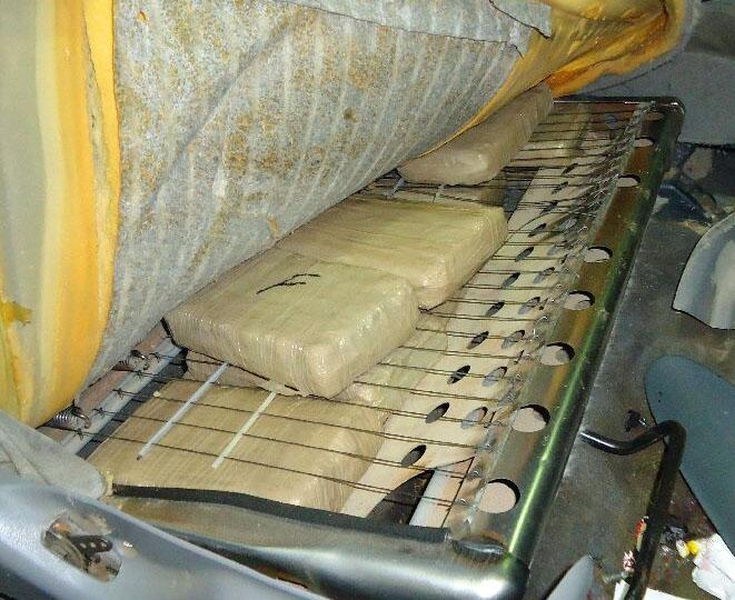 250 packages of marijuana removed from throughout a smuggling vehicle, including within the seats