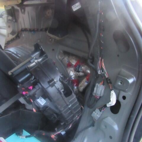Officers removed packages of meth from the center console as well as the rear quarter panels of a smuggling vehicle