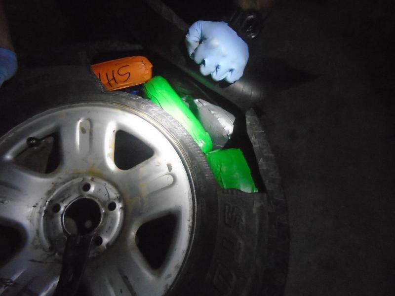 Officers found a variety of hard drugs inside of the spare tire of a smuggling vehicle