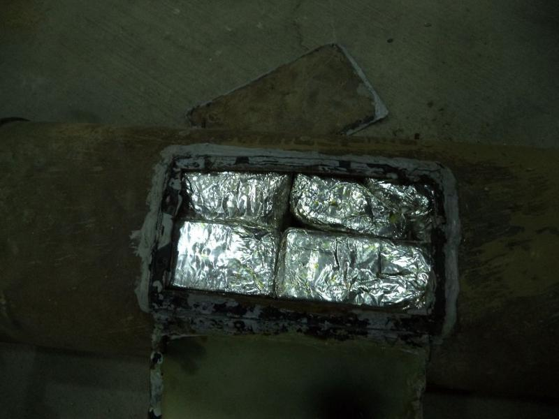 Twenty packages of meth were discovered inside a compartment within the muffler of a smuggling vehicle, by CBP officers