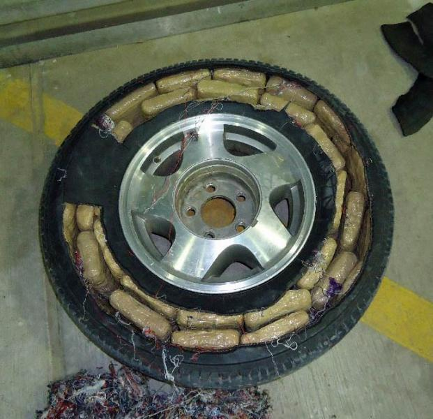Officers removed packages of marijuana from throughout a smuggling vehicle, as well as from within the front tires