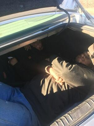 Agents discovered two illegal aliens inside the trunk of a smuggling vehicle