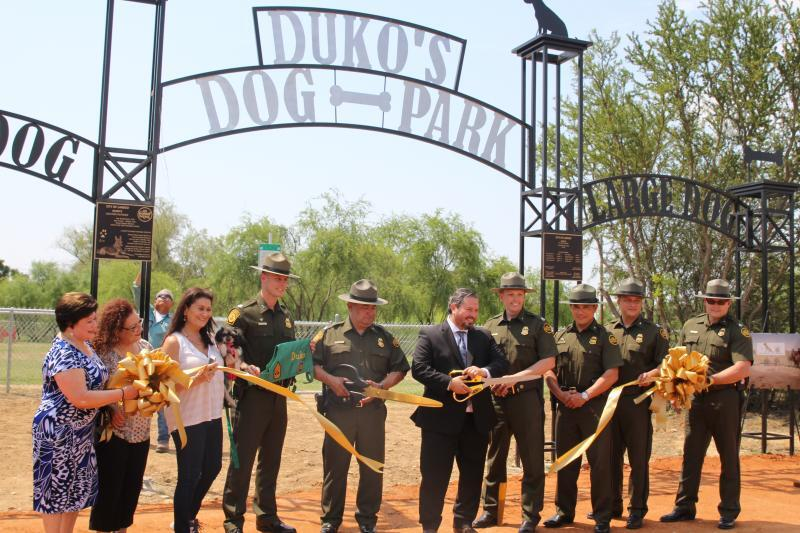 Ribbon cutting at the unveiling ceremony for Duko's dog park