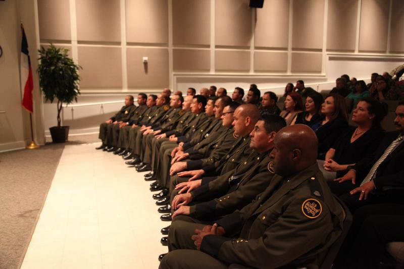 Laredo Sector Interim Border Patrol Chief Mario Martinez, presented new insignia ranks and certificates to 20 Border Patrol agents and 8 promotion certificates to Sector employees during a ceremony held yesterday at Texas A&M International University.