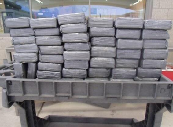 CBP officers discovered 94 packages of cocaine hidden within the flatbed trailer.