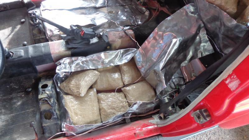 El Paso Border Patrol agents found 75 pounds of marijuana hidden in the floor of a vehicle.